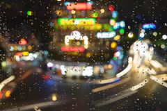 Rain water drops on a window glass after the rain with cityscape and street view on background.  Royalty Free Stock Photography