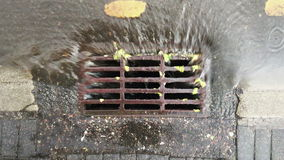 Rain water falling into sewerage. After downpour from the top view stock video