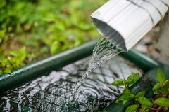 Rain water flowing down a filter stock photos