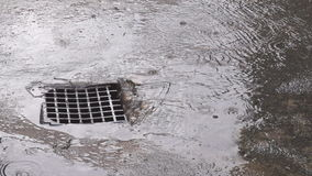 Rain Water Flowing Down in to Storm Drain. After rain water flowing down in to storm drain stock video