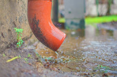 Rain water flowRainwater draining from drain pipe closeup Stock Photo