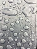 Rain water on grey background Stock Photos