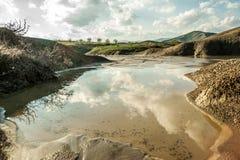Rain water reservoir over muddy volcanoes Stock Photos