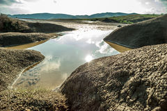 Rain water reservoir over muddy volcanoes Royalty Free Stock Photo