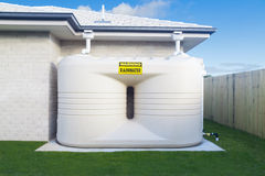 Rain water tank. Large rain water tank in suburban backyard Stock Photos