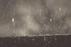 Rainwater falling on the wall to rebound, a beautiful background. The rain water on the walls, which look to rebound as the background.Vintage picture style Stock Photos