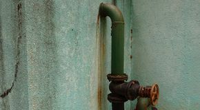 Rain water washes away traces of rust stock photos