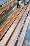 Rain water on a wooden bench Stock Photography