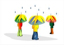 Rain weather. Three people under umbrellas with rain Stock Image