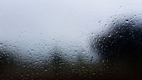 Rain wet window detail. Rain glass wet overcast window wash storm grey outside weather Stock Photo