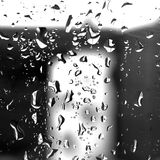 Rain on the Window. Black and white close-up of rain drops on a window Royalty Free Stock Photography