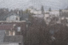 Rain from the window. Rain fall from the window with insect net Royalty Free Stock Photo
