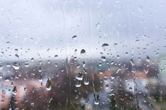 Rain on a window background. Rain drops on a window glass on a rainy day background Royalty Free Stock Photo