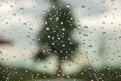Rain on window with blurred background Royalty Free Stock Photos