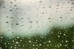 Rain on window with blurred background Royalty Free Stock Images
