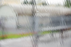 The rain on the window with blurred background. The rain on the window with blurred urban background stock illustration