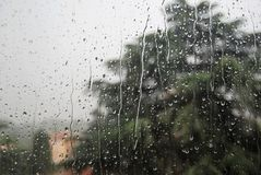 Rain on the window. Rain folling down over my head and over my window royalty free stock image