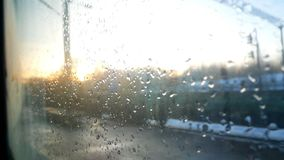 Rain window moving train. The rising sun from the window of a moving train or car stock video