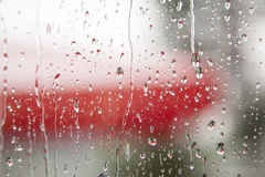 Rain on window pane Stock Images