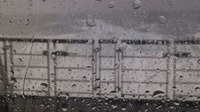 Rain on the window in a roaring 40s storm. Video of rain on the window in a roaring 40s storm stock video footage