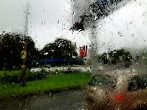 Rain at windows. Rain with outside, a rain inside Stock Images
