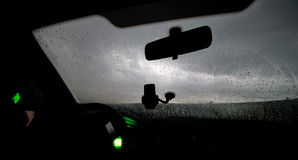Rain through the windshield of the car. Royalty Free Stock Photography