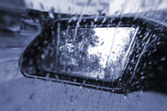 Rain on wing mirror Stock Images