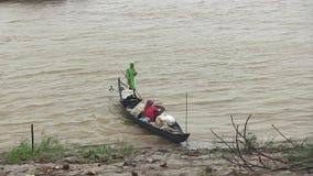 Rain, wood boat , mekong, cambodia, southeast asia stock footage