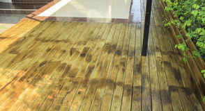 Rain on the wooden. Rain, wet wood floors Royalty Free Stock Photography