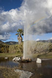 Rainbo Geyser. A natural geyser shooting water out of the ground and into the air Stock Photo