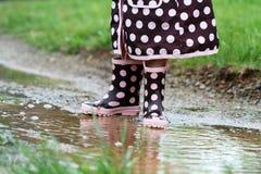 Rainboots e pozze di fango Immagine Stock Libera da Diritti
