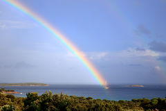 The rainbow ‹ the sailing Boat. Only a moment  to see the sailing boat under the rainbow Stock Photography