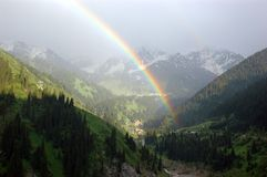 Rainbow. Bright rainbow in mountains after summer rain Royalty Free Stock Photos
