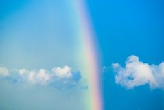 Rainbow. In the blue sky with white clouds Royalty Free Stock Photography