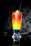 Rainbow. Layered cocktail called Rainbow containing blue curacao, peach and cherry juice Stock Image