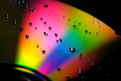 Rainbow. Water drops on colorful CD Royalty Free Stock Photography