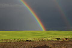 Rainbow. In the farming fields of the Palouse Stock Image