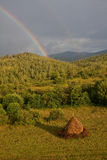 Rainbow. Landscape of a rainbow in the countryside of Romania Royalty Free Stock Photography