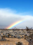 Rainbow. Desert Rainbow with blue sky Royalty Free Stock Photography