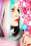 Rainbow. Beautiful young woman in rainbow colored hair with lollipops Royalty Free Stock Photography