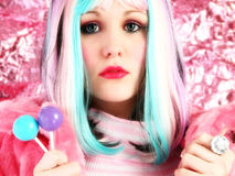 Rainbow. Beautiful young woman in rainbow colored hair with lollipops Stock Images
