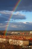 Rainbow. Over town in winter Stock Images