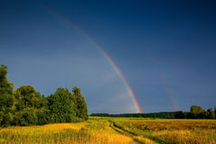 Rainbow. Landscape with country road and rainbow Stock Photo