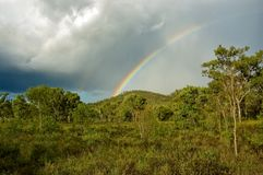 Rainbow. As a storm approaches in the afternoon a rainbow appeared above the mountain stock photos
