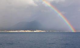 Rainbow. Against  sea landscape in rainy weather Stock Image