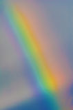 Rainbow. A rainbow (arcobaleno) background with clouds, traversed by the sun's rays Stock Images
