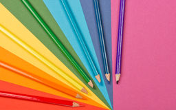 Rainbow. Background of differently colored papers and pencils Royalty Free Stock Photography