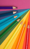 Rainbow. Background of differently colored papers and pencils Stock Images