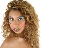 Rainbow. Headshot of a model with long curly flowing hair and rainbow make-up Stock Images