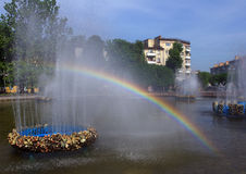 Rainbow. In  fountain in  summer Royalty Free Stock Image